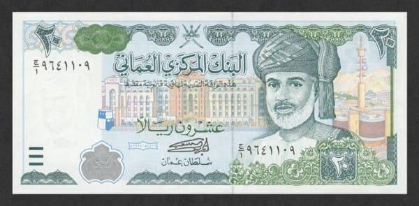 оманский реал - арабская строна